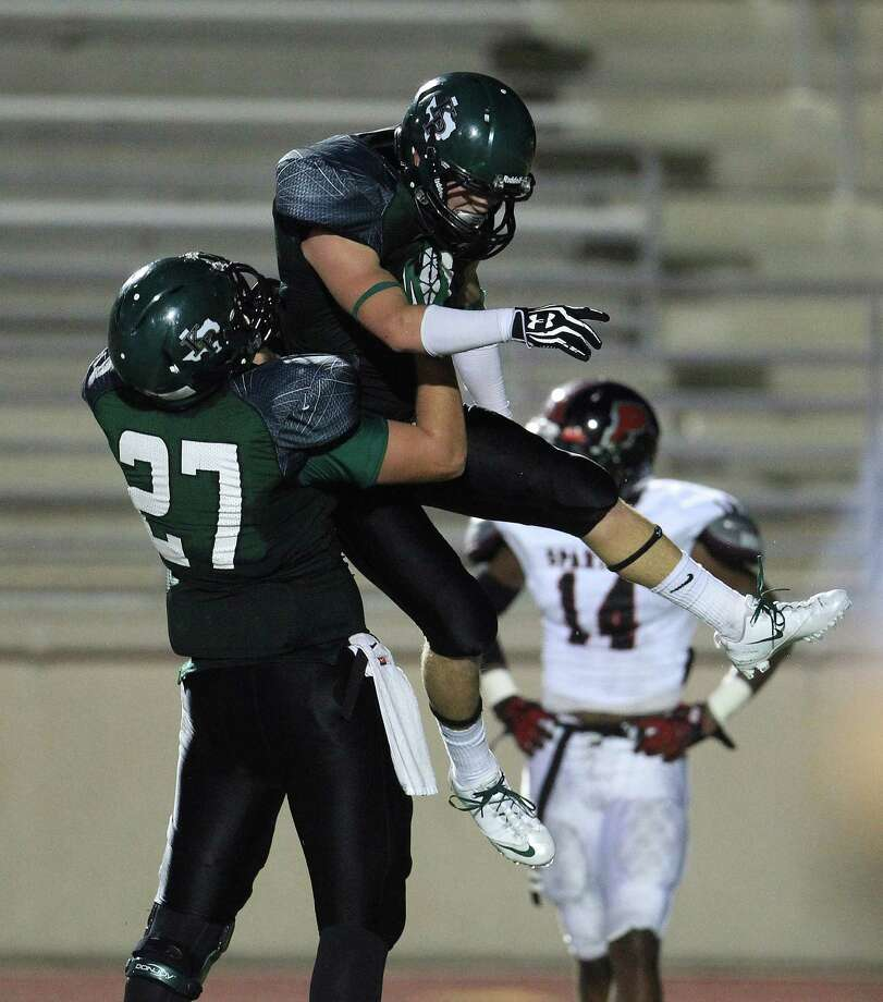 Kingwood Park's Jordan Feuerbacher (27) lifts up Joey Chapman (3) after his touchdown during the second quarter of the Porter-Kingwood Park High School football game at Turner Stadium, Thursday, Sept. 19, 2013, in Humble. Photo: Karen Warren, Houston Chronicle / © 2013 Houston Chronicle