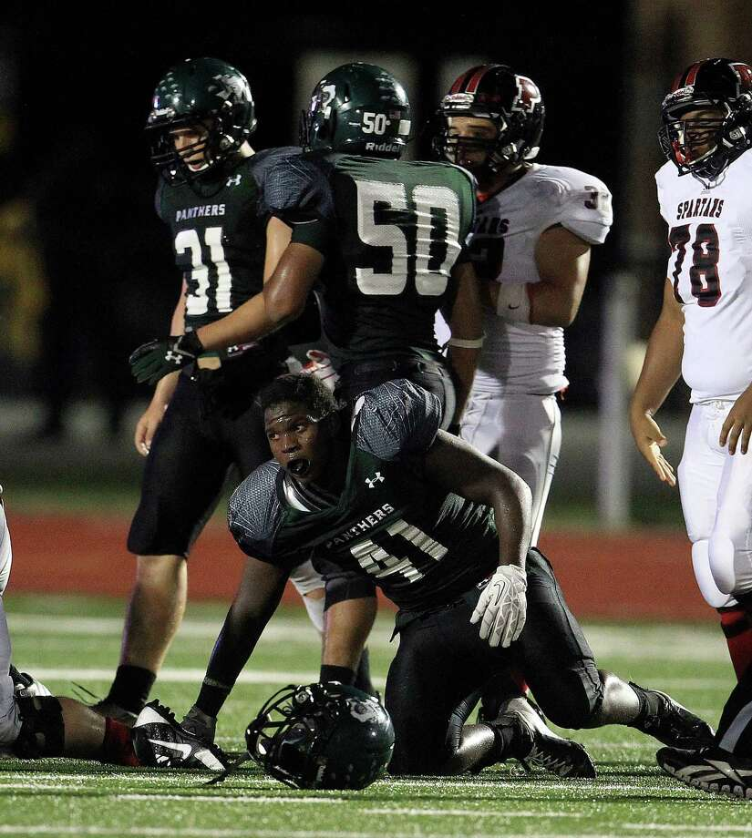Kingwood Park's Theko Orenic (41) gets up without his helmet after a play during the fourth quarter of the Porter-Kingwood Park High School football game at Turner Stadium, Thursday, Sept. 19, 2013, in Humble. Photo: Karen Warren, Houston Chronicle / © 2013 Houston Chronicle