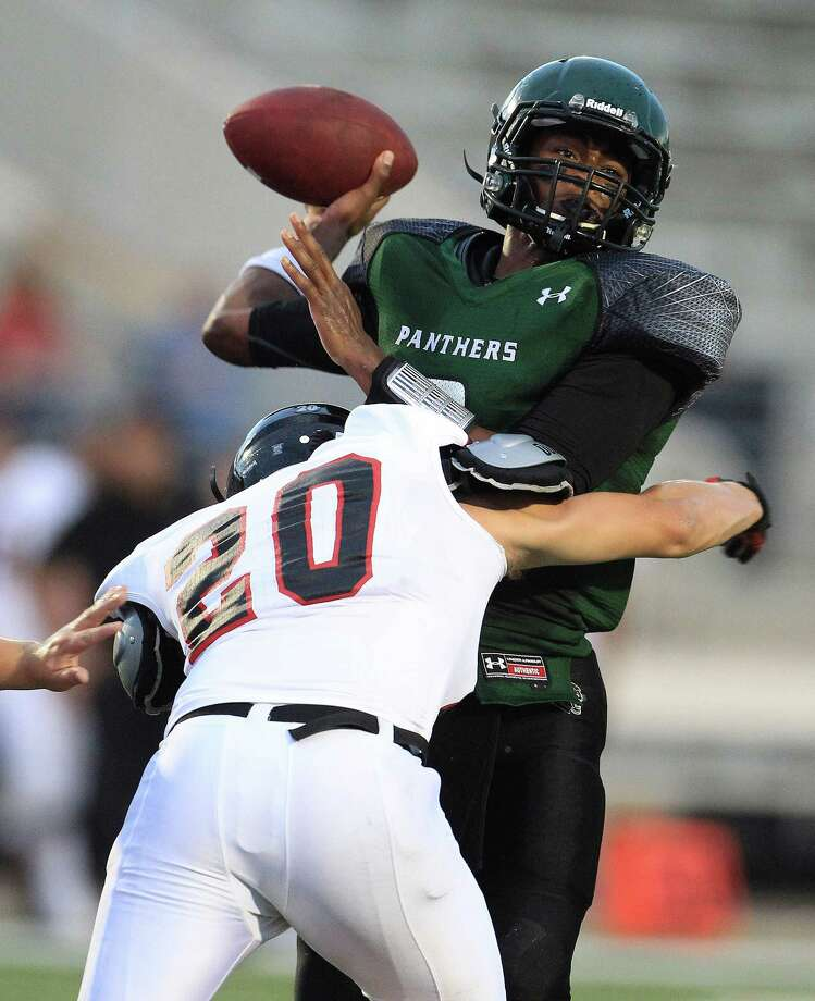 Kingwood Park's QB Jaylon Henderson (6) tries to get the ball thrown before getting tackled by Porter's Cole Morris (20) during the first quarter of the Porter-Kingwood Park High School football game at Turner Stadium, Thursday, Sept. 19, 2013, in Humble. Photo: Karen Warren, Houston Chronicle / © 2013 Houston Chronicle