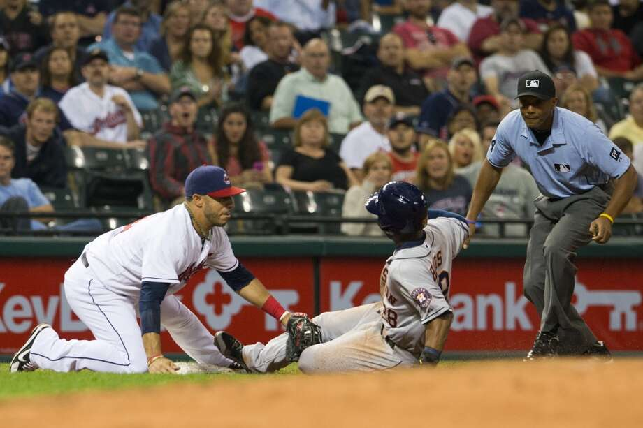 Sept. 19: Indians 2, Astros 1 (11)Third baseman Mike Aviles #4 of the Indians tags out L.J. Hoes #28 of the Astros as third base umpire CB Bucknor #54 watches. Photo: Jason Miller, Getty Images