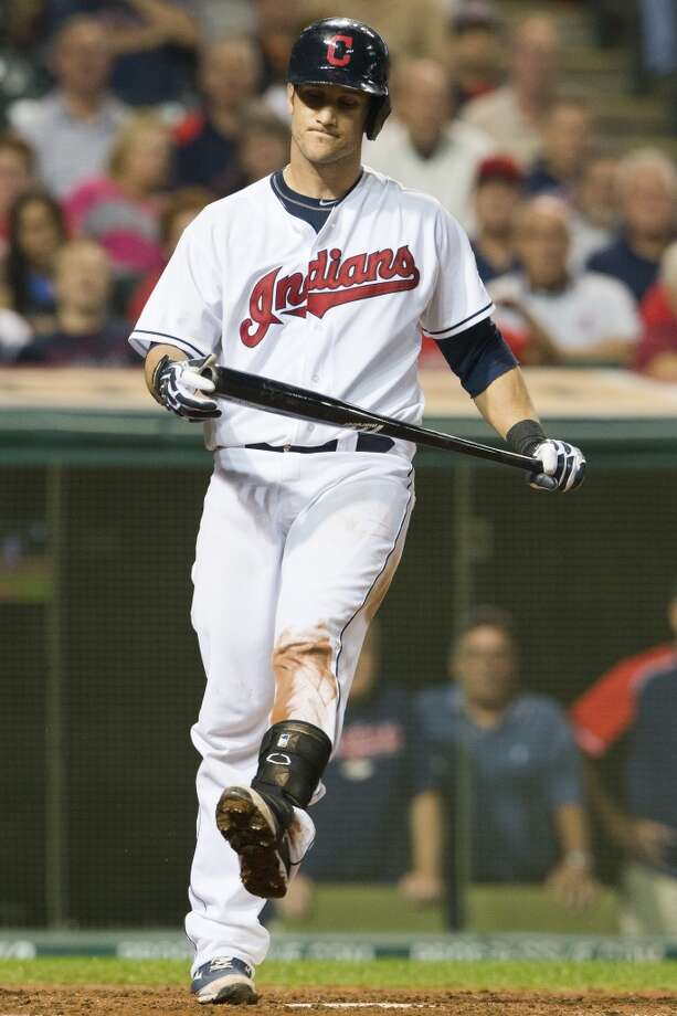 Yan Gomes #10 of the Indians reacts after swinging for a strike. Photo: Jason Miller, Getty Images