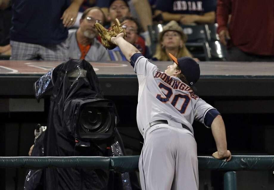 Astros third baseman Matt Dominguez catches a pop foul off the bat of Carlos Santana. Photo: Mark Duncan, Associated Press