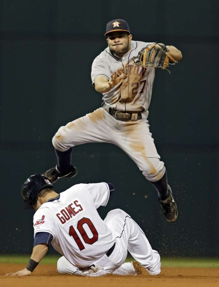Astros second baseman Jose Altuve avoids the slide of Yan Gomes (10) at second but his relay is too late to complete a double play. Photo: Mark Duncan, Associated Press