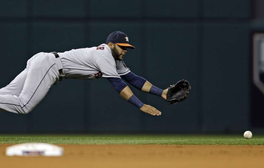 Astros shortstop Jonathan Villar dives but can't catch a single by Yan Gomes. Photo: Mark Duncan, Associated Press