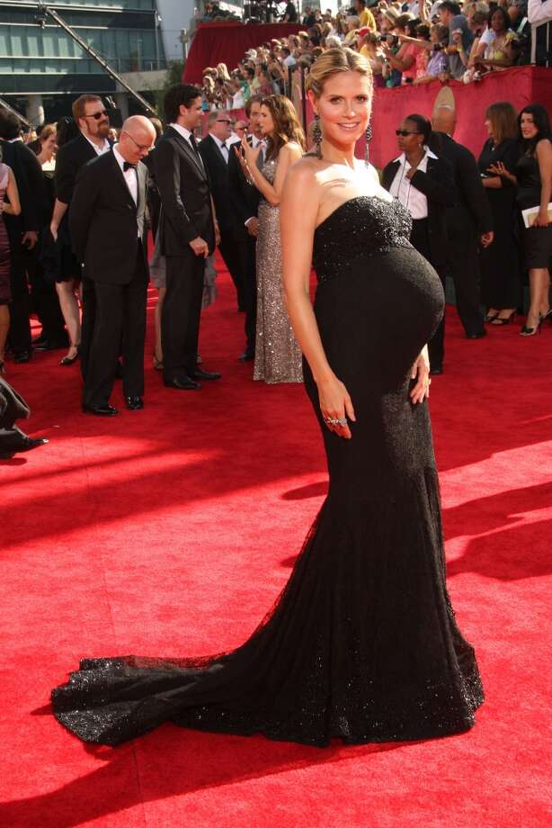 """Hit:Heidi Klum, 2009. We realize this has turned into the """"Heidi Klum maternity style"""" portion of this slideshow, but seriously, Klum knows how to make it work. Photo: Jason Merritt, Getty Images"""