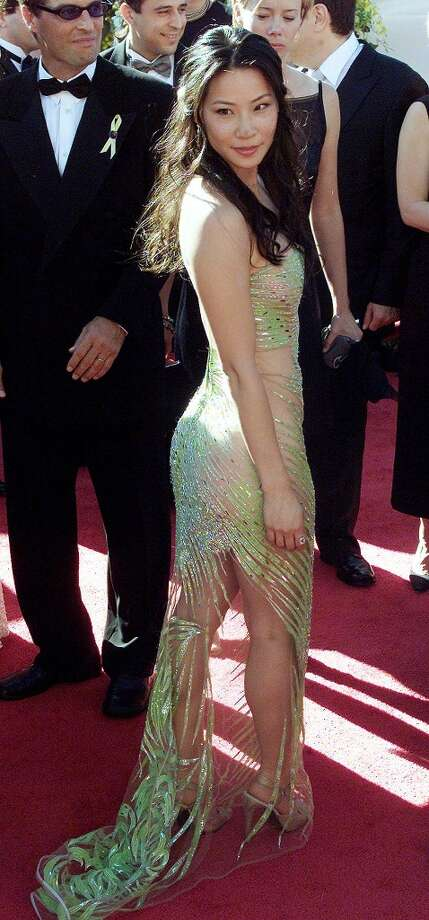 Hit:Lucy Liu, 2000. Liu looks beautiful in this green Versace gown. Note: This is the same year that Jennifer Lopez plunged down to there, also in a green Versace, at the Grammys. Photo: Scott Nelson, AFP/Getty Images
