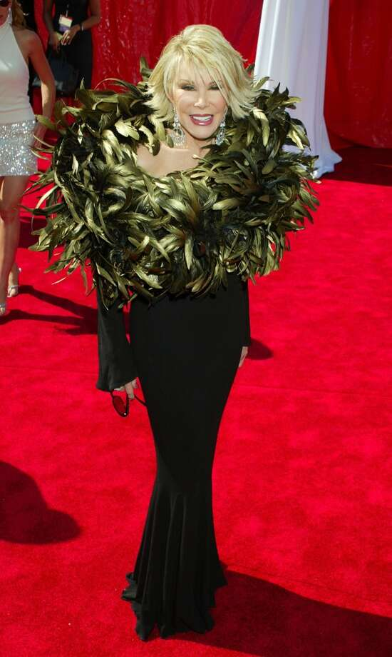"Miss: Joan Rivers, 2003. Now the host of E!'s ""Fashion Police,"" Rivers' had her own fashion faux pas that involves feathers. Lots and lots of feathers. Photo: Jeffrey Mayer, WireImage"