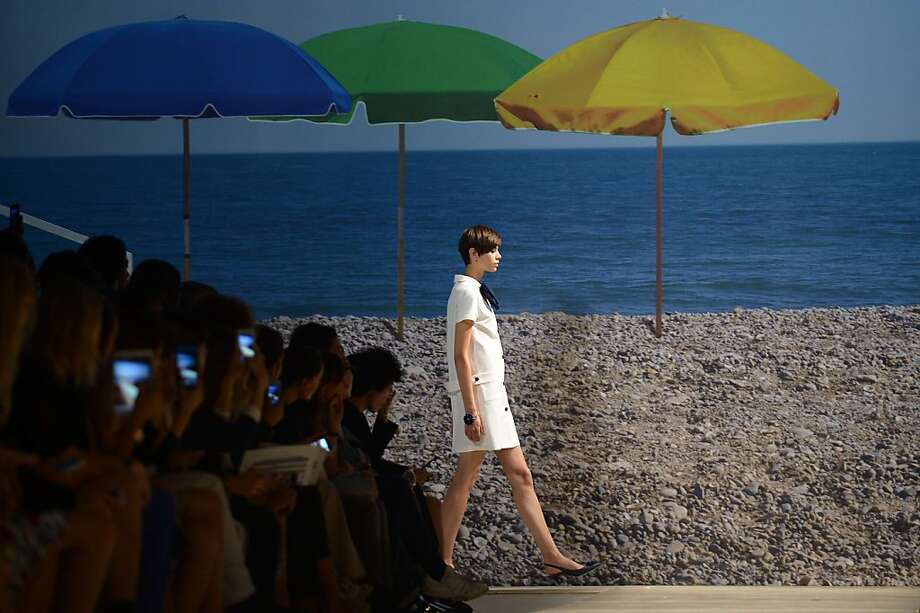TOPSHOTS A model presents a creation for fashion house Blugirl as part of the spring/summer 2014 ready-to-wear collections during the fashion week in Milan on September 19, 2013.  AFP PHOTO / FILIPPO MONTEFORTEFILIPPO MONTEFORTE/AFP/Getty Images Photo: Filippo Monteforte, AFP/Getty Images