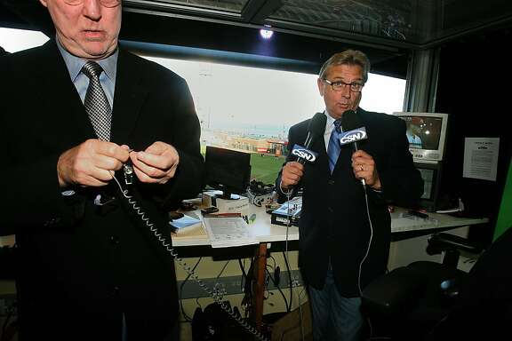 Play by play announcer Duane Kuiper (right) playfully mugs the camera as he holds the microphones a minute before showtime at AT&T park in San Francisco, Calif., on Thursday, April 12, 2010.  Announcer Jon Miller (left) getting his equipment ready.