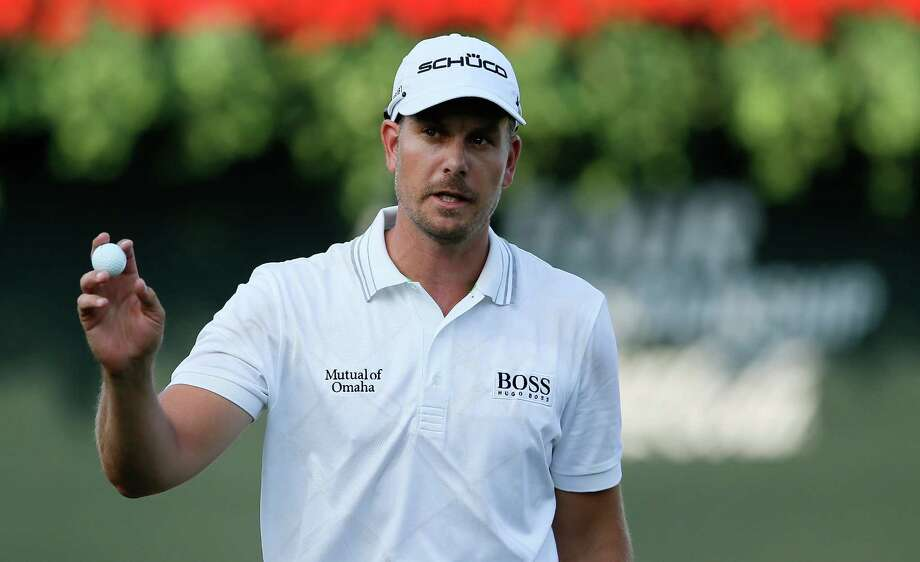 ATLANTA, GA - SEPTEMBER 19:  Henrik Stenson of Sweden walks across the 18th green after a six-under par 64 during the first round of the TOUR Championship by Coca-Cola at East Lake Golf Club on September 19, 2013 in Atlanta, Georgia.  (Photo by Kevin C. Cox/Getty Images) ORG XMIT: 159810281 Photo: Kevin C. Cox / 2013 Getty Images