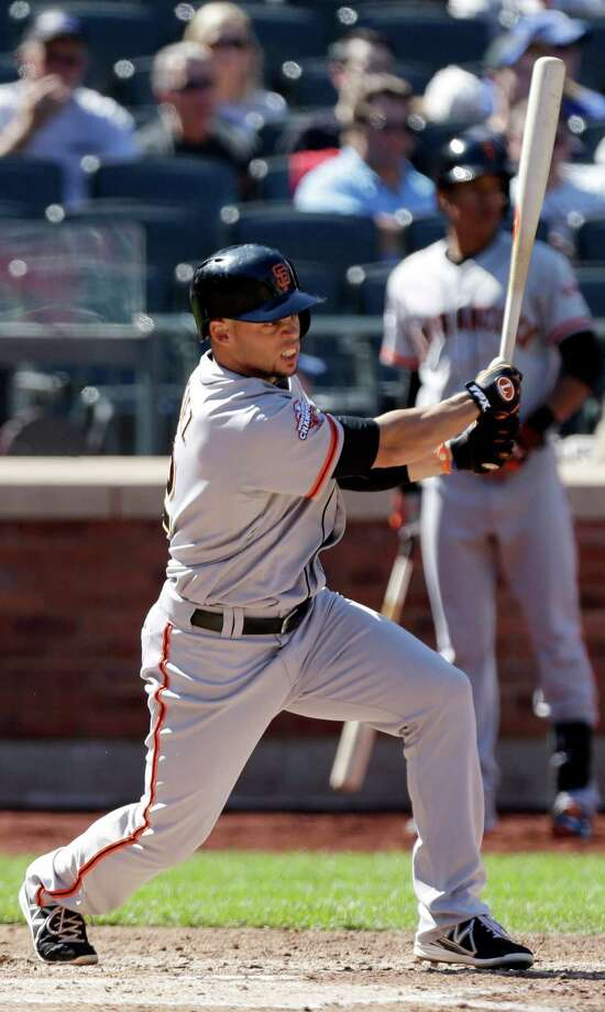 San Francisco Giants' Juan Perez hits an RBI single during the fourth inning of a baseball game against the New York Mets Thursday, Sept. 19, 2013, in New York.  (AP Photo/Frank Franklin II) ORG XMIT: NYM106 Photo: Frank Franklin II / AP