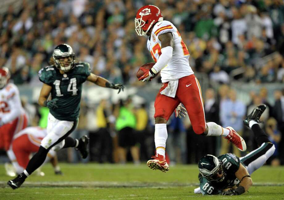 Kansas City Chiefs cornerback Sean Smith (27) leaps in the air after he intercepted a pass as Philadelphia Eagles wide receiver Riley Cooper (14) and tight end Zach Ertz defend during an NFL football game Thursday, Sept. 19, 2013, in Philadelphia. (AP Photo/The Express-Times, Matt Smith)  ORG XMIT: PAEAS108 Photo: Matt Smith / Express-Times