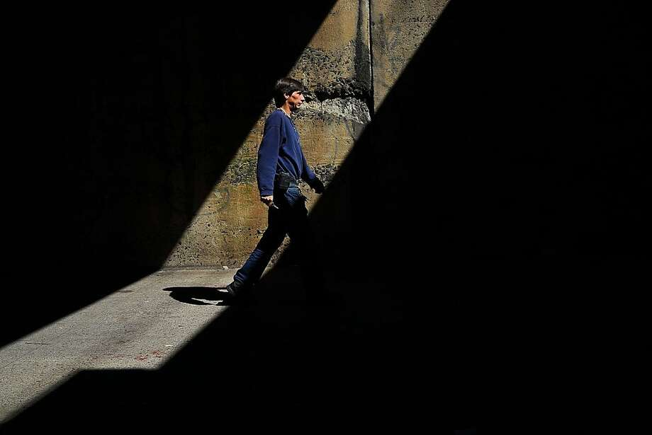 "NEW YORK, NY - SEPTEMBER 19: A man walks under a bridge in the South Bronx on September 19, 2013 in New York City.  According to the 2010 U.S. Census Bureau report, over a quarter-million people in the South Bronx are living in poverty, making the 16th Congressional District the poorest in the nation. New Census Bureau numbers for all of New York City show that the poverty rate has risen to 21.2 percent in 2012, from 20.9 percent the year before. As New Yorkers prepare to vote for their next mayor following Michael Bloomberg, the Democratic candidate Bill de Blasio has focused on the theme that New York has transformed into a ""tale of two cities"" under the Bloomberg administration.  (Photo by Spencer Platt/Getty Images) Photo: Spencer Platt, Getty Images"