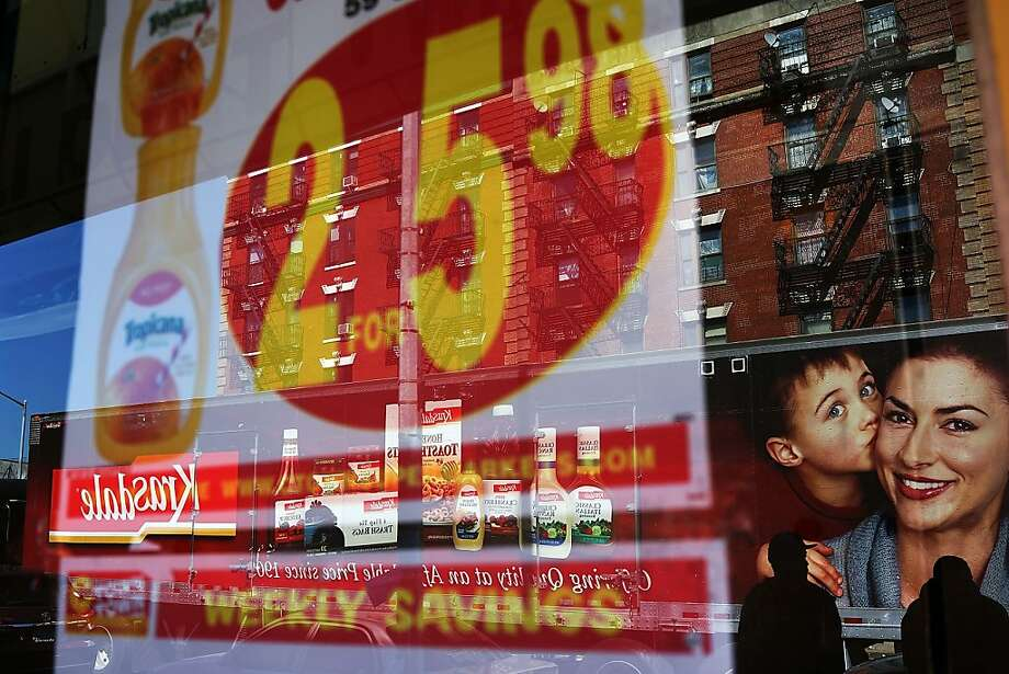 "NEW YORK, NY - SEPTEMBER 19: Grocery store advertising posted in a window in the South Bronx on September 19, 2013 in New York City.  According to the 2010 U.S. Census Bureau report, over a quarter-million people in the South Bronx are living in poverty, making the 16th Congressional District the poorest in the nation. New Census Bureau numbers for all of New York City show that the poverty rate has risen to 21.2 percent in 2012, from 20.9 percent the year before. As New Yorkers prepare to vote for their next mayor following Michael Bloomberg, the Democratic candidate Bill de Blasio has focused on the theme that New York has transformed into a ""tale of two cities"" under the Bloomberg administration.  (Photo by Spencer Platt/Getty Images) Photo: Spencer Platt, Getty Images"