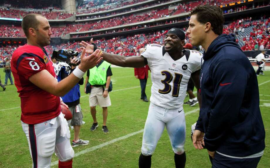 Texans quarterback Matt Schaub, left, and linebacker Brian Cushing, right, exchanges pleasantries with former teammate Bernard Pollard after last season's win. Photo: Brett Coomer, Staff / © 2012  Houston Chronicle