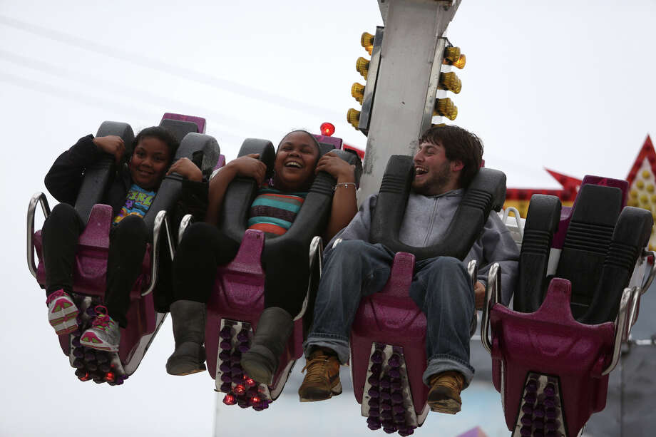 People enjoy a ride during the 2013 Washington State Fair in Puyallup. The Washington State Fair, formerly known as the Puyallup Fair, has drawn large crowds each day since it opened on Sept. 6. The Fair continues through Sunday, Sept. 22. Photo: JOSHUA TRUJILLO, SEATTLEPI.COM / SEATTLEPI.COM