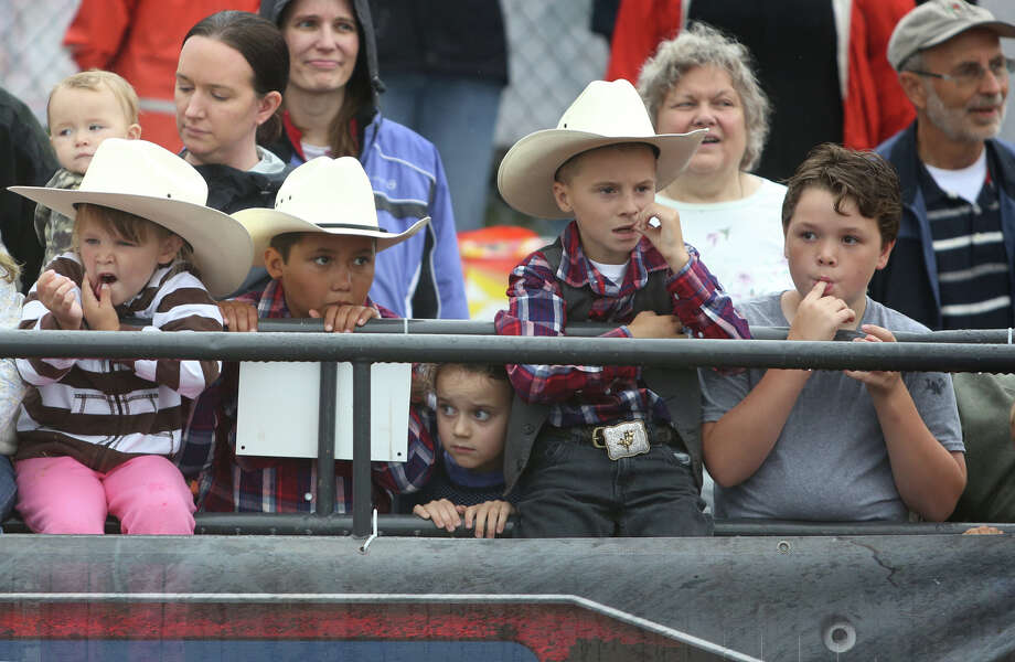 Young buckaroos watch a round of mutton busting during the 2013 Washington State Fair in Puyallup. The Washington State Fair, formerly known as the Puyallup Fair, has drawn large crowds each day since it opened on Sept. 6t The Fair continues through Sunday, Sept. 22. Photo: JOSHUA TRUJILLO, SEATTLEPI.COM / SEATTLEPI.COM