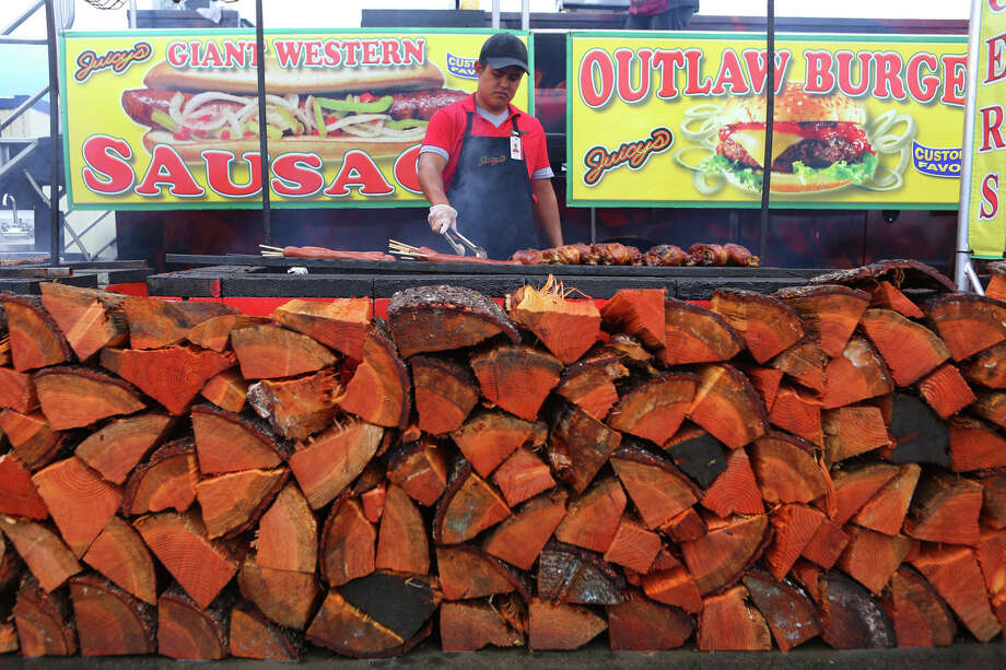 Food is grilled during the 2013 Washington State Fair in Puyallup. The Washington State Fair, formerly known as the Puyallup Fair, has drawn large crowds each day since it opened on Sept. 6. The Fair continues through Sunday, Sept. 22. Photo: JOSHUA TRUJILLO, SEATTLEPI.COM / SEATTLEPI.COM