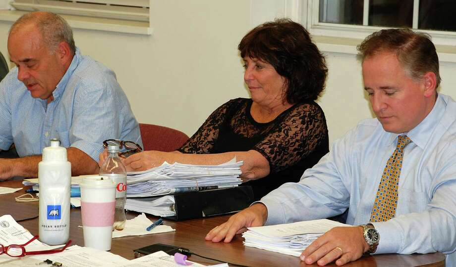 Three Planning and Zoning Commission members, from left, Chip Stephens, Catherine Walsh and Jack Whittle, had voiced support for relocating the Gunn House to the Baldwin parking lot, but four P&Z colleagues voted Thursday against the plan.  WESTPORT NEWS, CT 9/19/13 Photo: Jarret Liotta / Westport News contributed