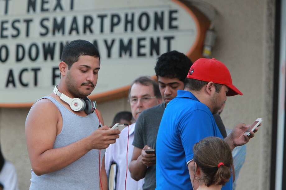 Eager Houstonians looking to purchase the new iPhone waited outside an AT&T store on Chimney Rock early Friday morning to secure a device. (Mayra Beltran / Houston Chronicle) Photo: Mayra Beltran, Houston Chronicle