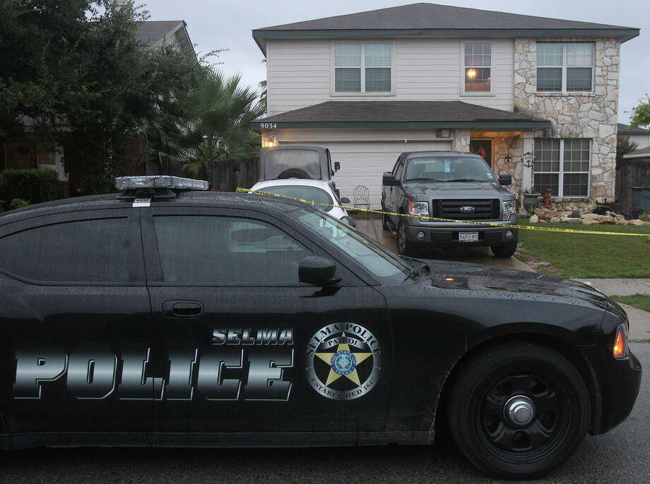A law enforcement official is parked in front of a home Friday September 20, 2013 on the 9,000 block of Pinseeker in Selma, Texas where two Selma police officers were allegedly shot shortly after 10:30 p.m. last night while responding to a domestic disturbance call. According to early reports, police were able to return fire at the suspect who also was allegedly shot. The officers and the suspect were taken to San Antonio Military Medical Center for treatment. Their conditions are unknown at this time. Photo: JOHN DAVENPORT, SAN ANTONIO EXPRESS-NEWS / ©San Antonio Express-News/Photo may be sold to the public
