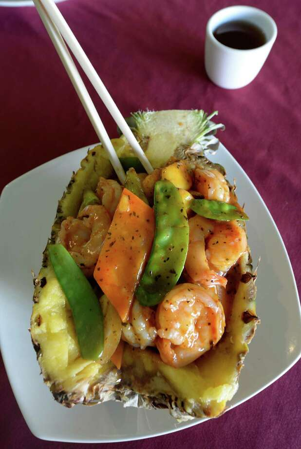 Ocean Palace. 68 Central Ave., Albany.Fresh pineapple bowl with jumbo shrimp in a red currie sauce from the Ocean Palace Tuesday Sept 17, 2013 in Albany, N.Y.         (Skip Dickstein/Times Union) Photo: SKIP DICKSTEIN / 00023890A