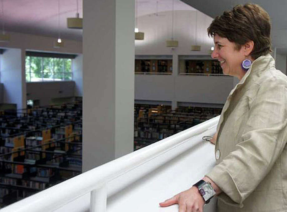 Maxine Bleiweis, the Westport Library director surveying the facilities, will speak to the Y's Women on Monday about future plans for the library. Photo: File Photo / Westport News