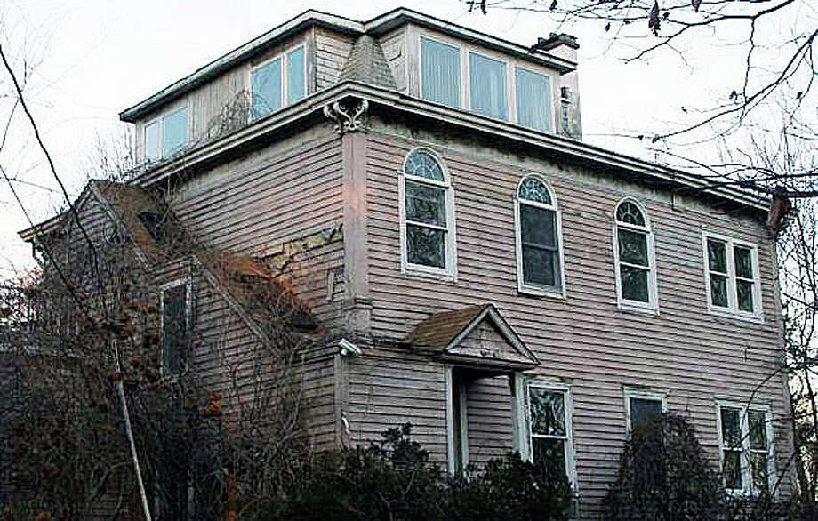 This former home stands on the Ludlow Road property where Congregation Beit Chaverim had proposed building a new house of worship. The Planning and Zoning Commission on Thursday turned down the latest application. WESTPORT NEWS, CT 9/19/13 Photo: File Photo / Westport News