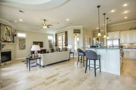 Scaling down a 39 move up 39 for cinco ranch patio home buyers houston chronicle - Ranch americain poet interiors houston ...