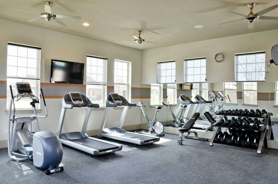 The Ashfield Club, an amenity for residents of Ashfield Gardens in Cinco Ranch, includes a fitness room, kitchen, and indoor and outdoor gathering areas.