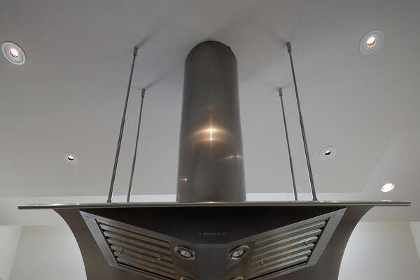 High-heat ranges and cooktops require equally powerful range hoods to draw smoke out of the kitchen.
