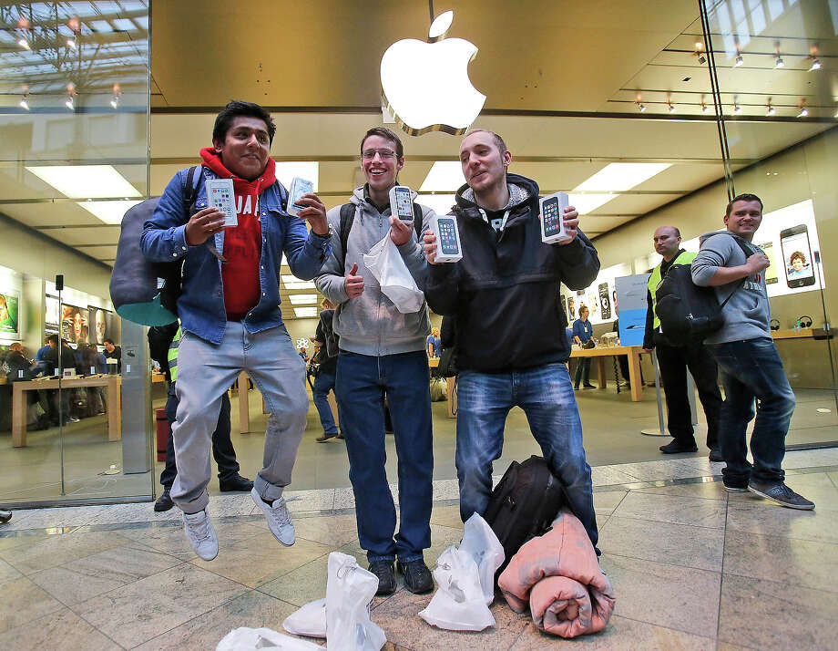 First customers of the Apple store in Oberhausen celebrate with the first iPhones in hand at the start of the new iPhone sale in Oberhausen, Germany, Friday. Photo: Frank Augstein, ASSOCIATED PRESS / AP2013