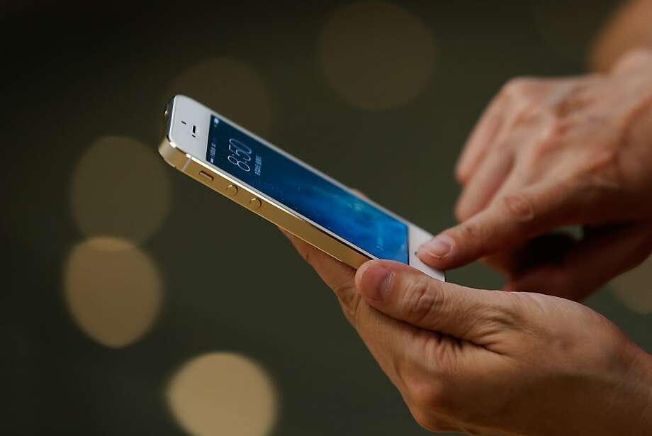 Smartphones such as Apple iPhones use fingerprint recognition. (Photo by Lintao Zhang/Getty Images) Photo: Lintao Zhang, Getty Images