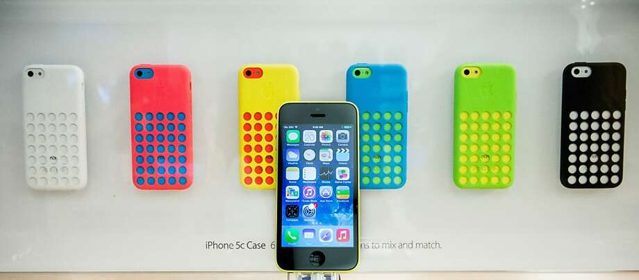 The iPhone 5C is seen on display at the Fifth Avenue Apple store on Friday in New York City. Apple launched two new models of iPhone: the iPhone 5S, which is preceded by the iPhone 5, and a cheaper, paired down version, the iPhone 5C. The phones come with a new operating system. Photo: Andrew Burton, Getty Images