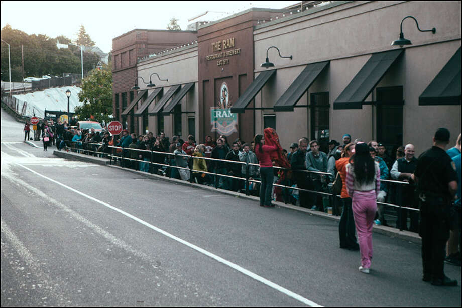 People were lining up before dawn at Seattle's University Village to get the new iPhone.