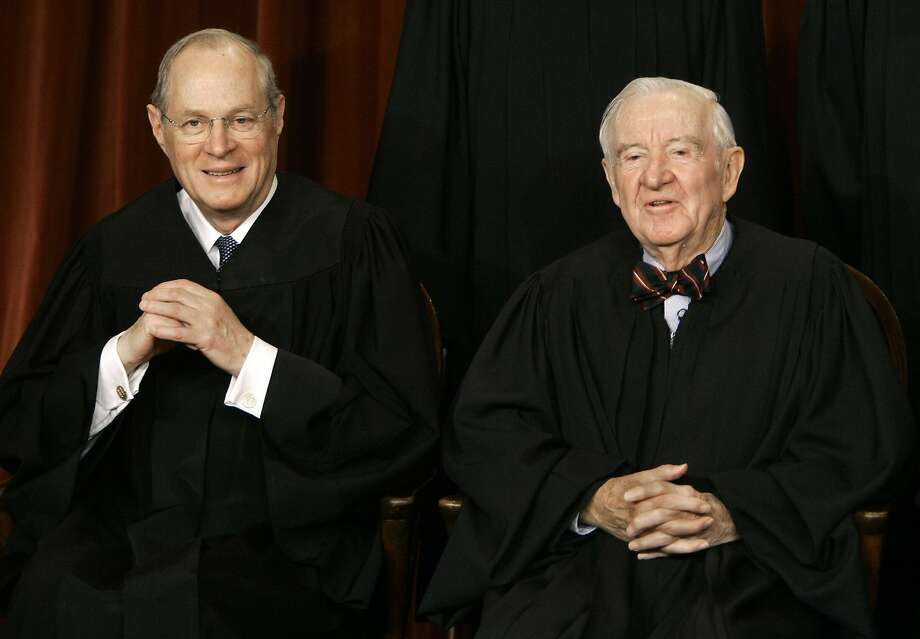 Washington, UNITED STATES:  US Supreme Court justices Anthony Kennedy (L) and John Paul Stevens smile as the justices pose for their class photo 03 March 2006 inside the Supreme Court in Washington, DC.     AFP PHOTO/Paul J. RICHARDS  (Photo credit should read PAUL J. RICHARDS/AFP/Getty Images) Photo: Paul J. Richards, AFP/Getty Images