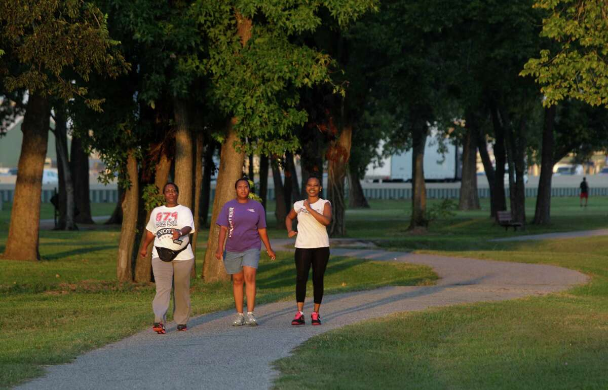 Sherean Goodie, left, Tanya Wilson, and LaTreice Garrett, right, walk in Hutcheson Park near Lockwood and 610, Wednesday, Oct. 17, 2012, in Houston. Parks By You is working to promote the bond measure on the Nov. 6 ballot that would include connecting the Hutcheson Park to the Mickey Leland Memorial Park, 3701 Cavalcade Street, by extending Hunting Bayou Hike and Bike Trail.