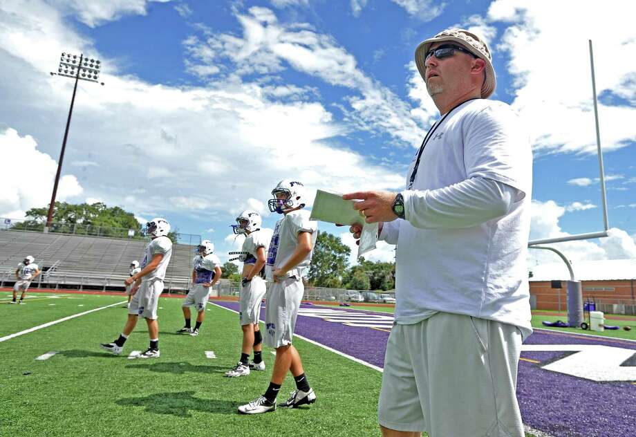 Port Neches High School head coach Brandon Faircloth takes the field with the Indian football team for the last practice during their bye week.  Photo taken Thursday, September 19, 2013. Photo taken: Randy Edwards/The Enterprise Photo: Randy Edwards, Photojournalist / Enterprise