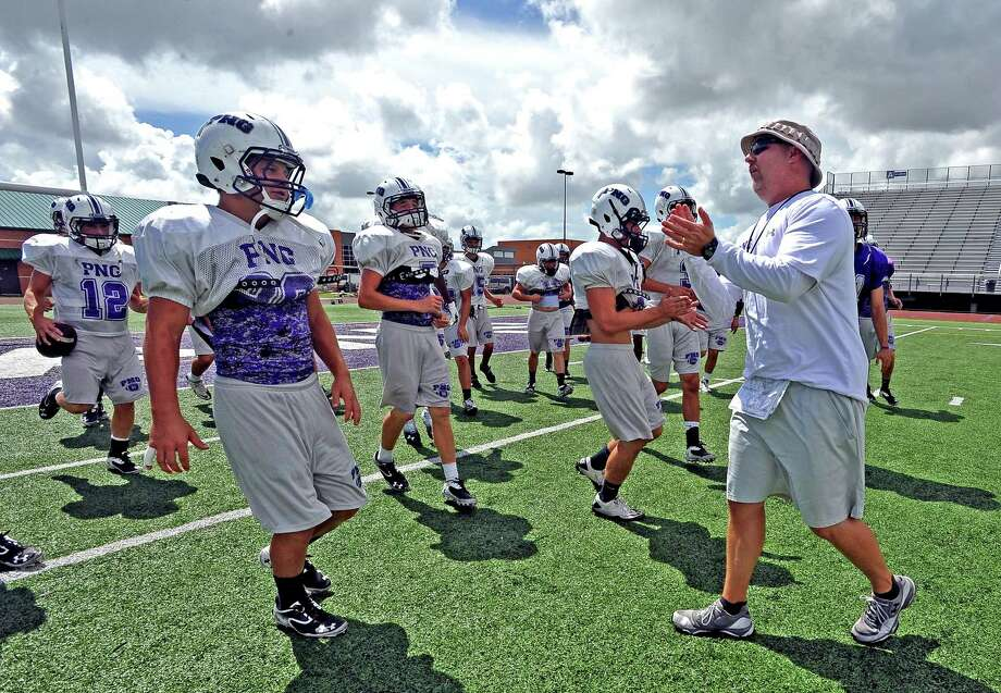 Port Neches High School head coach Brandon Faircloth takes the field with the Indian football team for the last practice during their bye week.  Photo taken Thursday, September 19, 2013.