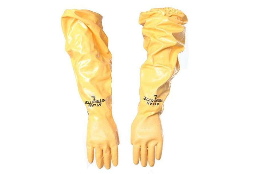 "Yellow Hazmat Gloves""These yellow protective gloves were shown onscreen in Breaking Bad.""See the item at ScreenBid.com Photo: ScreenBid.com"