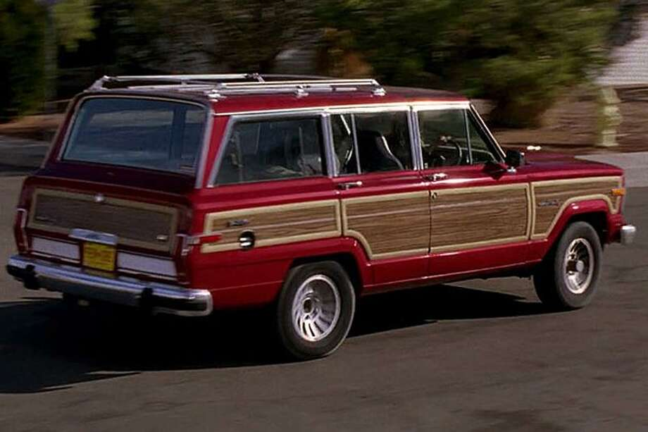 """Skyler White's 'Breaking Bad' Jeep:""""Skyler White, Walt's wife, drives this unique and highly recognizable 1991 Jeep Grand Wagoneer throughout Breaking Bad. The Jeep runs and drives, but leaks oil and has some paint bubbling and chipping. This is the very Jeep that Skyler, played by Anna Gunn, drives through New Mexico. Skyler's car can be yours only at ScreenBid. This vehicle is sold as-is.""""See the item at ScreenBid.com Photo: ScreenBid.com"""