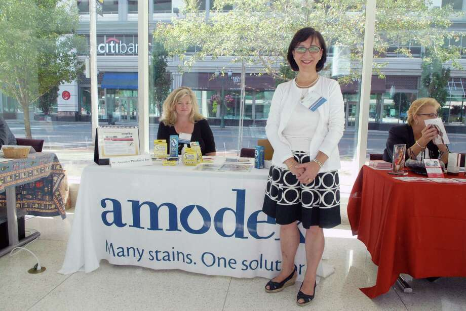 Beverlee Dacey is the president of the Bridgeport company Amodex and stands by her booth at Connecticut's first ever statewide conference aimed at supporting women entrepreneurs which was held at the University of Connecticut's Stamford campus on Friday September 20, 2013. Photo: Dru Nadler / Stamford Advocate Freelance