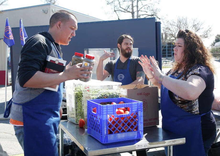 The Blue Team plans their strategy during the field test on MasterChef.