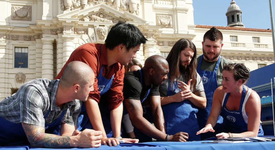 The Blue Team plans their strategy during a field test on MasterChef.