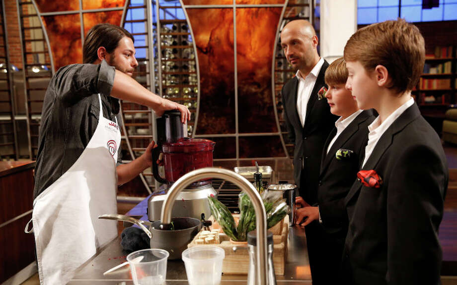 James discusses his dessert with judge Joe Bastianich and his sons, Ethan and Miles.
