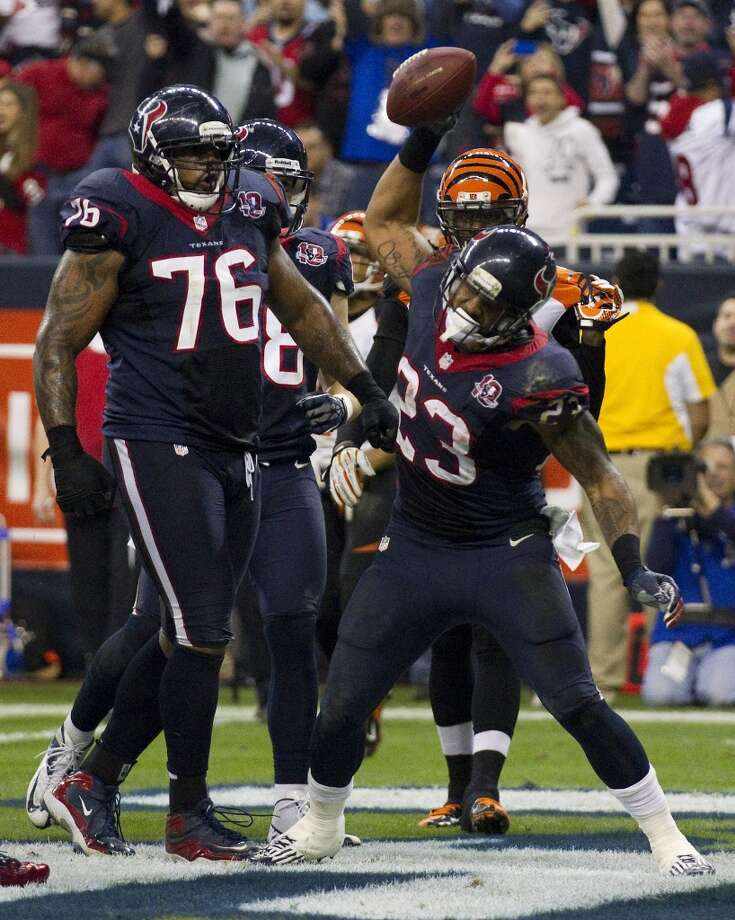 Foster punctuates a touchdown with a spike. Photo: Brett Coomer, Houston Chronicle