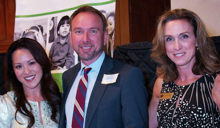 Near & Far Aid recently presented one of its annual Community Compassion Awards to Harman International of Stamford. Near & Far Aid corporate giving chairwomen Kim Meier and Joan Panagos flank  Darrin Shewchuk of Harman. Photo: Contributed Photo / Westport News contributed