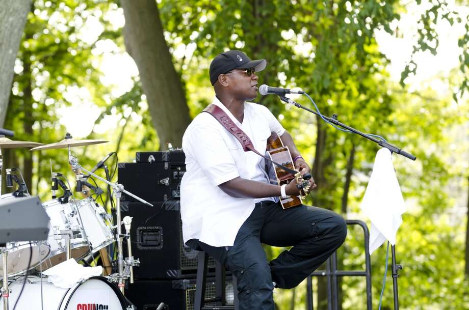 Javier Colon, winner of The Voice television singing competition, performs during the first annual Shakesbeer Festival Beer Festival at the American Shakespeare Theatre on Elm Street in Stratford on Saturday, Aug. 17, 2013. He will be at the Bijou Theatre in Bridgeport, Conn., on Friday, Sept. 20, 2013. Photo: Amy Mortensen Photo: Amy Mortensen
