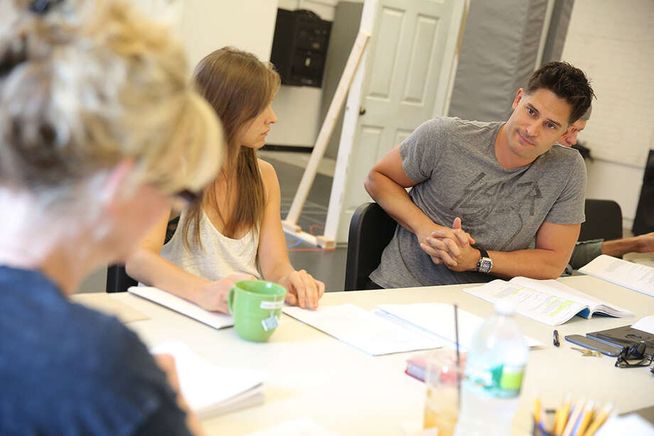 "Gathered around a rehearsal table for the Yale Repertory Theatre production of ""A Streetcar Named Desire"" are - left to right - Rene Augesen as Blanche, Sarah Sokolovic as Stella, and Joe Manganiello as Stanley. The Tennessee Williams classic begins performances in New Haven, Conn., on Friday, Sept. 20, 2013. Photo: Contributed Photo / Connecticut Post Contributed"