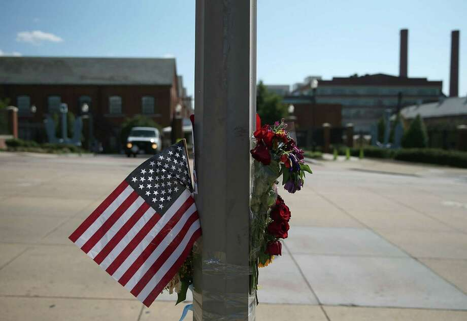 Condolence notes and flowers are hung on a pole across he street from the front gate of the Washington Navy Yard where a gunman    shot and killed 12 people before being shot and killed by police. The lack of mental health treatment is the real problem with the wave of mass shootings. Photo: Mark Wilson, Getty Images / 2013 Getty Images
